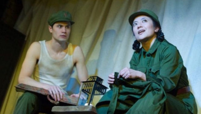 Andrew Leung as Xu and Louise Mai Newberry as Tang in 'The Sugar-Coated Bullets of the Bourgeoisie, Arcola Theatre. Photo by Alastair Muir