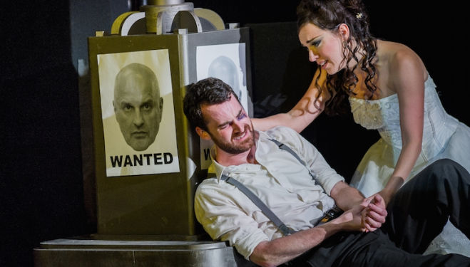 A wanted Don Giovanni (Christopher Purves) looks on as Zerlina (Mary Bevan) consoles Masetto (Nicholas Crawley) in Don Giovanni. Photograph: Robert Workman