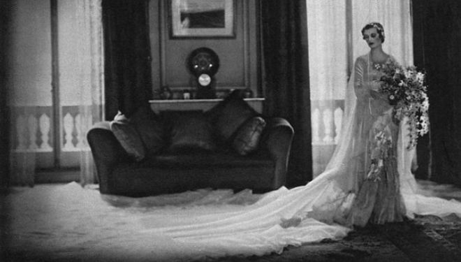 Embroidered silk satin wedding dress by Norman Hartnell, 1933 Given and worn by Margaret, Duchess of Argyll © Illustrated London News Ltd/Mary Evans