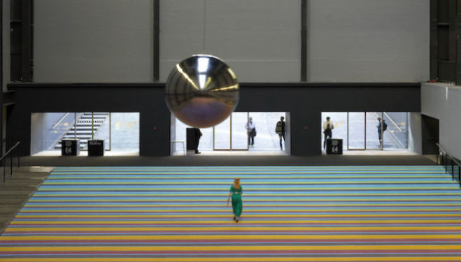 The Tate's Turbine Hall has been filled with dozens of three-seater swings