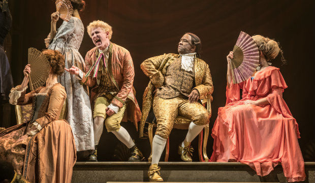 Adam Gillen as Wolfgang Mozart and Lucian Msamati as Antonio Salieri in Amadeus at the National Theatre. Photo by Marc Brenner