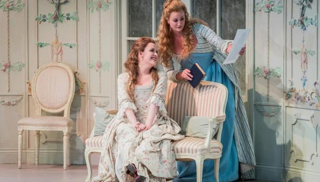 Kitty Whately and Eleanor Dennis weigh up the odds in Così Fan Tutte at Opera Holland Park. Photo: Robert Workman