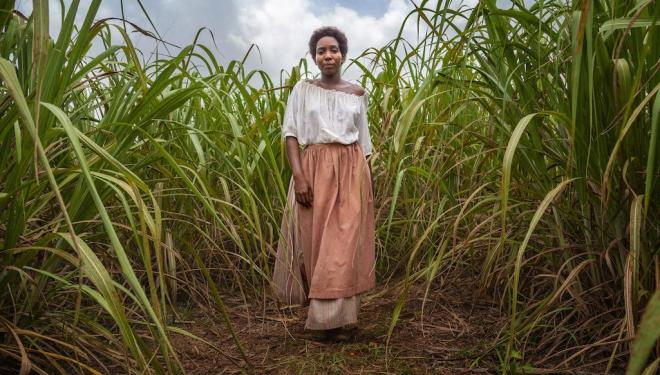 Tamara Lawrance plays July, a Jamaican slave in the 19th century