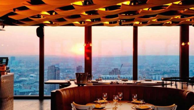 The Duck and Waffle overlooks the bright lights of the city