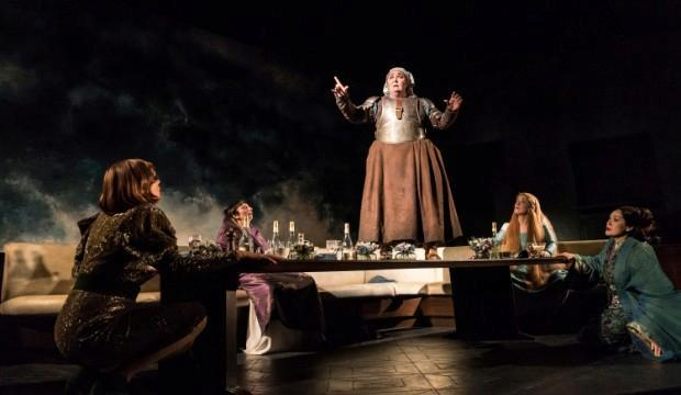 A scene from Top Girls by Caryl Churchill. Centre standing Ashley McGuire, Dull Gret.  Image by Johan Persson