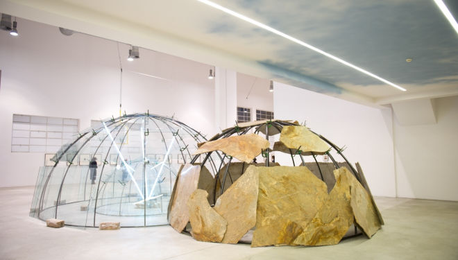 "Merz, Mario Movements of the Earth and the Moon on an Axis, 2003 Triple igloo, metal tubes, glass stone, neon, clamps, clay 19' 7"" X 16' 4"" x 9' 8"", courtesy of Pace"