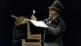 Paterson Joseph (Scrooge) in A Christmas Carol at The Old Vic. Credit: Manuel Harlan