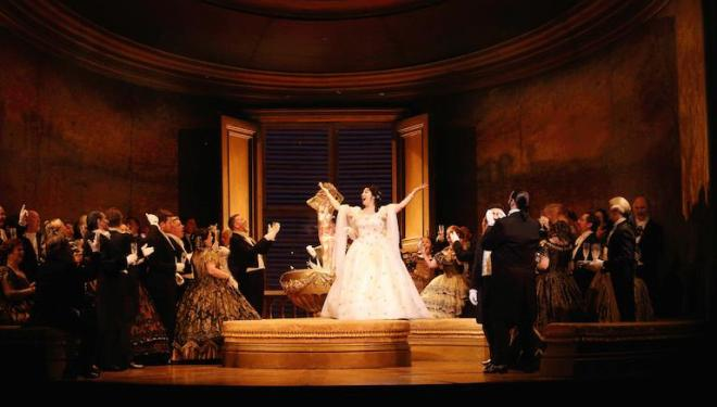Violetta entertains in Act One of Verdi's La Traviata at the Royal Opera House. Photo: Catherine Ashmore