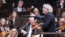 Sir Simon Rattle conducts the London Symphony Orchestra, whose performances are free to view on YouTube. Photo: Tristram Kenton