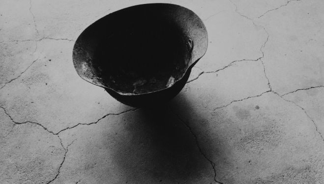 From Conflict, Time Photography: Helmet with Skull Bone Fused by Atomic Bomb, Nagasaki 1963; Toshio Fukada