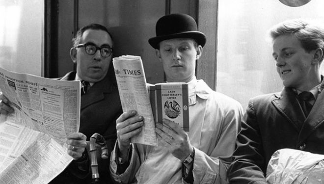 1960: Fox photographer George Freston poses as a commuter on the tube, reading a copy of D H Lawrence's novel Lady Chatterley's Lover, on the day the book went on ...