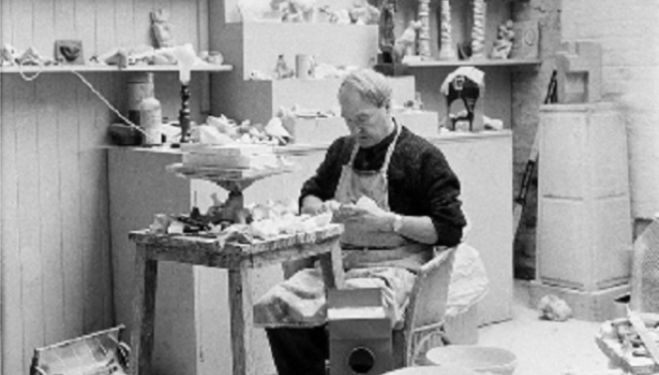 HENRY MOORE working on a plaster in the Maquette Studio, Perry Green, c. 1960. Photo by John Hedgecoe. Reproduced by permission of The Henry Moore Foundation