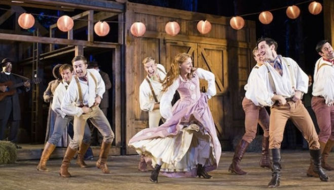 Laura Pitt-Pulford as Milly with the Brothers: Open Air Theatre Seven Brides for Seven Brothers photo by Helen Maybanks