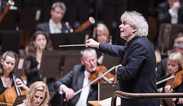 Sir Simon Rattle is leaving Berlin to conduct the London Symphony Orchestra. Photograph: Tristram Kenton