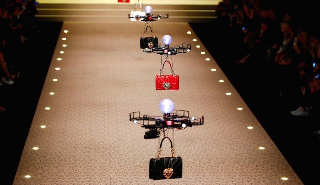A fleet of drones carrying bags at D&G's AW18 show
