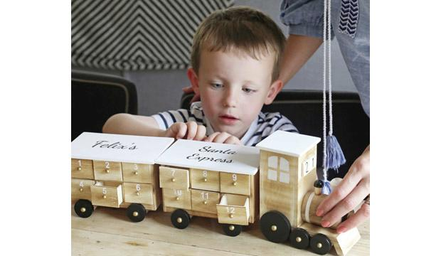 For their first Christmas: Personalised Wooden Train Advent Calendar, £39